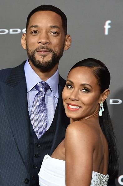 will smith and wife jada pinkett smith at the premiere of warner bros pictures focus